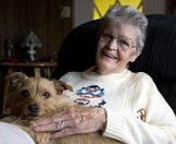 Kathrine Neubauer sits with her dog Guss