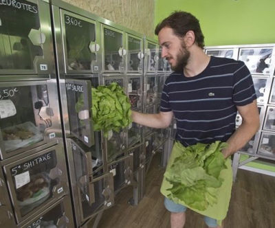 elivery man Michael Luminau puts greens in automat boxes in Paris, France. Joseph Petit employs no staff at his two Paris stores