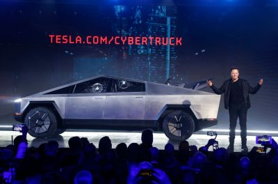 Elon Musk's Tesla aims to deliver 500,000 cars and sport-utility vehicles this year, though the company said economic uncertainty will make that more difficult