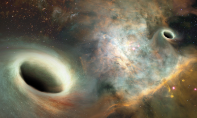 Artist's conception shows two supermassive black holes, similar to those observed by UNM researchers, orbiting one another more than 750 million light years from Earth